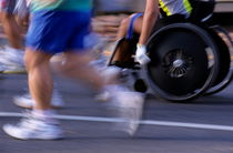 Runners and disabled people in wheelchairs racing together by Sami Sarkis Photography
