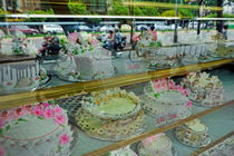 Cakes behind a store window by Sami Sarkis Photography