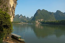 Boat moored on the banks of the River Li in Xinping by Sami Sarkis Photography