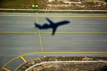 Shadow of an airplane taking off. by Sami Sarkis Photography