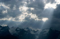 Sunbeams playing over the Barre des Ecrins and La Meije mountains in the French Alps by Sami Sarkis Photography