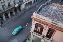 Vintage car driving through the streets of Havana by Sami Sarkis Photography