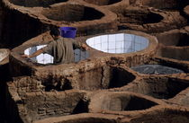 Man working in a tannery by Sami Sarkis Photography