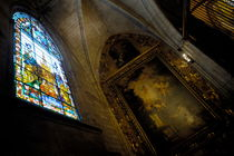 Religious painting and stained glass window inside a chapel at the Seville Cathedral by Sami Sarkis Photography