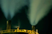 Petroleum refinery chimneys at night by Sami Sarkis Photography