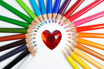Heartshape and Circle of colorful crayons by Sami Sarkis Photography