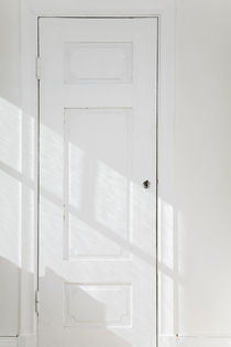 Old fashioned white closet door by kbhsphoto