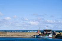 Old-fashioned fishing boat inside breakwater on Gotland, Sweden by kbhsphoto