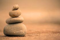 warm balanced pebbles by Dan Davidson