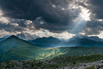 A sunbeam pierces clouds over Marmolada in the Dolomites, Italy by Tom Dempsey