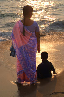 Woman in Pink and Blue Sari with Child Varkala by serenityphotography