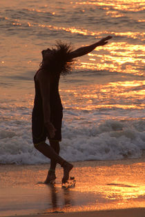 Dancing in the Surf at Sunset by serenityphotography