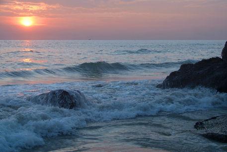 Water-on-the-rocks-at-sunset-varkala