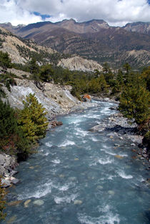 River and Clouds near Manang von serenityphotography