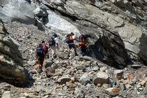 Trekkers Climbing over Landslide by serenityphotography
