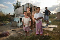 Gypsykids in front of their house-to-be-built by Peter van Beek