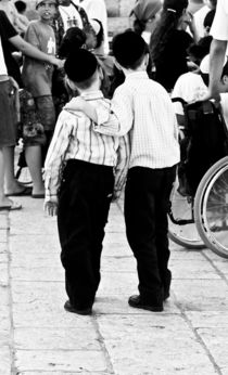 Two brothers in the heart of Jerusalem, near to a Wailing Wall, Israel von yulia-dubovikova