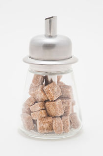 Sugar dispenser filled with brown sugar cubes by Lars Hallstrom