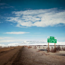 milepost at the Dempster Highway by Priska  Wettstein