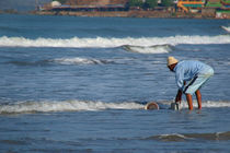 Cleaning-buckets-in-the-sea-arambol