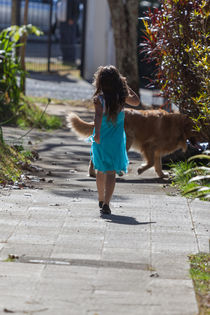 young girl walking her dog  by Craig Lapsley