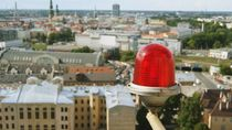 Big red light on focus.Background - panorama of Riga by Daria Phobia