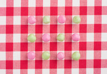 Candy on a red and white chequered tablecloth by Lars Hallstrom