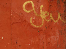 Not you - graffiti in gold on an orange wall von Marjolein Katsma