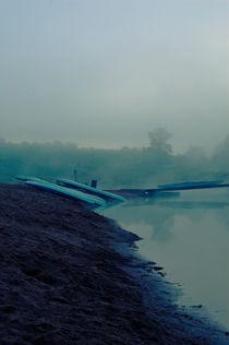 kayak on the beach by Kamil Sypien