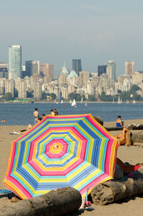 Colourful Beach Umbrella by John Mitchell