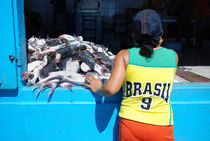 Brasilian woman looking at Fishmonger's shop